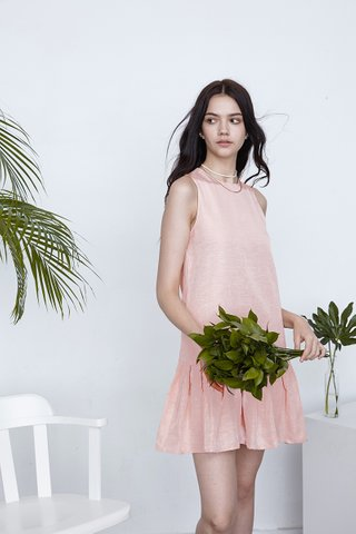 Stephanie pleats and Drop hem dress in Champagne pink